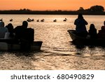 shooting pelicans at the sunset | Shutterstock . vector #680490829