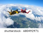 two skydivers are flying in the ... | Shutterstock . vector #680492971