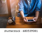 woman holding smartphone | Shutterstock . vector #680539081