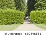 White Iron Gate Inside Green...