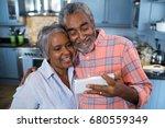 smiling couple taking selfie...   Shutterstock . vector #680559349
