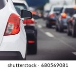 cars in row waiting in traffic... | Shutterstock . vector #680569081