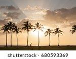 sunset palm beach with a man's...   Shutterstock . vector #680593369