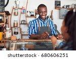 smiling barista standing behind ... | Shutterstock . vector #680606251