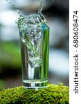 a glass of fresh water and a... | Shutterstock . vector #680608474