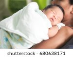 baby in mother embrace | Shutterstock . vector #680638171