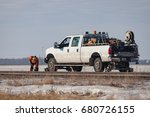 A rail worker is working on track beside a white pickup rail truck - stock photo