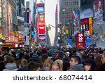 TIMES SQUARE - DECEMBER 31:  Huge crowds form in Times Square In Manhattan for New Years Eve on December 31, 2010 in Times Square, New York City. - stock photo
