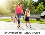 mom and schoolgirl of primary... | Shutterstock . vector #680799295
