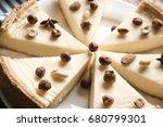delicious sliced cheesecake... | Shutterstock . vector #680799301