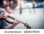 street musician playing violin | Shutterstock . vector #680819044