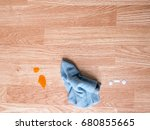 blue rag with stain on wooden... | Shutterstock . vector #680855665