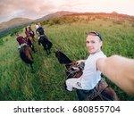 male rider on horseback holds a ... | Shutterstock . vector #680855704