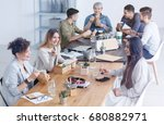 colleagues chatting about a new ... | Shutterstock . vector #680882971