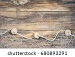 Fishing net on old wood, maritime nautical background texture.