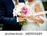 wedding bouquet in the hands of ... | Shutterstock . vector #680903689