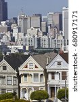 Small photo of SAN FRANCISCO, USA - AUG 13 2013: Alamo square and the Painted Ladies Victorian houses in San Francisco, with city skyline in the background