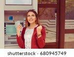 withdraw.  atm. portrait happy... | Shutterstock . vector #680945749