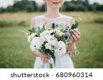bride in a white dress is... | Shutterstock . vector #680960314