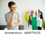 bored husband waiting for wife | Shutterstock . vector #680979235