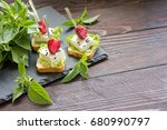delicious canapes wiyh feta... | Shutterstock . vector #680990797