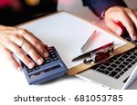 man works on calculator. | Shutterstock . vector #681053785