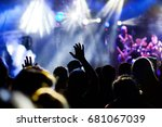 crowd with raised hands at... | Shutterstock . vector #681067039