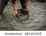 Small photo of gold panning in a glacial river in Austria, separate heavy and light material, searching gold