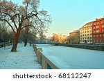 winter river in historic town - stock photo