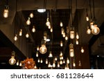 Many Light Bulbs Hanging By...