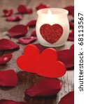 two red hearts and burning candle for valentines day - stock photo