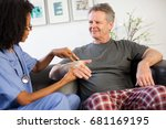 nurse visiting man with wrist... | Shutterstock . vector #681169195