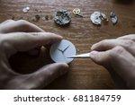 a watch maker is repairing a