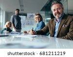 businesspeople looking at... | Shutterstock . vector #681211219