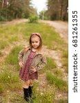 happy girl in a summer park   Shutterstock . vector #681261355