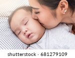 close up of mother kissing her... | Shutterstock . vector #681279109