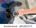 woman refueling the car with... | Shutterstock . vector #681301171
