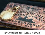 Small photo of Livorno, Italy - july 2015: Wooden Board Ouija: Communication with Spirits