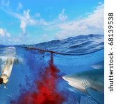 Image split two parts underwater and oceanview. Sharks attack swimmers underwater through cloud of blood - stock photo