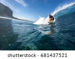 muscular surfer riding on big... | Shutterstock . vector #681437521