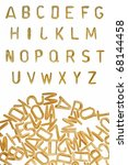 Small photo of Alphabet soup pasta font design element. Kids food background.