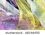 Thin colorful scarves for use as a background. - stock photo