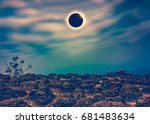 Small photo of Amazing scientific natural phenomenon. Total solar eclipse with diamond rinf effect glowing on sky above wilderness area in forest. Serenity nature background. Cross process.