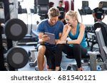 smiling personal trainer using... | Shutterstock . vector #681540121