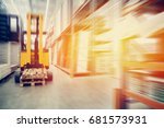 Small photo of Warehouse industrial premises for storing materials and wood, there is a forklift for containers. Concept logistics, transport. Motion blur effect. Bright sunlight.