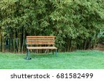 A Wooden Bench And Black Shoes...