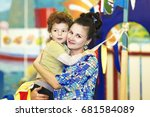 happy mother and little son... | Shutterstock . vector #681584089
