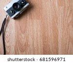 retro camera in wooden... | Shutterstock . vector #681596971