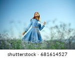 woman in a field of chamomile... | Shutterstock . vector #681614527
