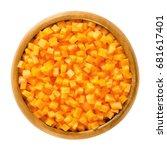 carrot cubes in wooden bowl.... | Shutterstock . vector #681617401